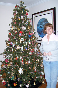 Kathy showing off her Christmas tree, after spending a good part of the day decorating the house. (Image taken with KODAK EASYSHARE C653 ZOOM DIGITAL CAMERA at ISO 160, f2.7, 1/60 sec and 6mm)