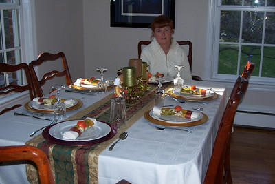 Kathy at the table she has set for Thanksgiving. (Image taken with KODAK EASYSHARE C653 ZOOM DIGITAL CAMERA at ISO 80, f3.0, 1/60 sec and 7.6mm)
