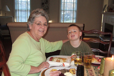 Mary Clare and her grandson, Christopher, enjoying Thanksgiving dinner (27 Nov 2008) (Image taken with FinePix F10 at ISO 800, f2.8, 1/100 sec and 8mm)