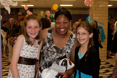 Sydney and Meredith with Ms. Breedy, their PE teacher. Taylor Elementary 5th Grade Graduation (15 Jun 2009) (Image taken with Canon EOS 20D at ISO 400, f4.0, 1/60 sec and 23mm)
