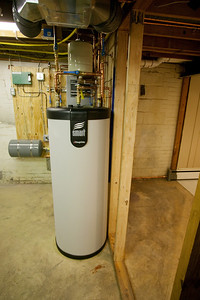 Smart 50 indirect fired water heater installed by Foley Mechanical, Inc. The Smart 50 is a tank-in-tank design, i.e., the boiler water in the external tank transmits heat to the internal tank that contains the domestic hot water. We won't be running out of hot water as the boiler can quickly heat this tank. (Image taken by Patrick R. Kane with Canon EOS-1DS at ISO 400, f4.0, 1/20 sec and 19mm)