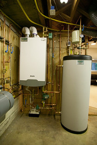 Triangle Tube Prestige 110 modulating condensing (MODCON) boiler and Smart 50 indirect fired water heater installed by Foley Mechanical, Inc. (Image taken by Patrick R. Kane with Canon EOS-1DS at ISO 400, f4.0, 1/15 sec and 17mm)