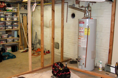 The Foley Mechanical, Inc., crew was kind enough to work around the hot water heater for the day, which allowed us to have hot water overnight. (Image taken by Patrick R. Kane with FinePix F10 at ISO 800, f2.8, 1/100 sec and 8mm)