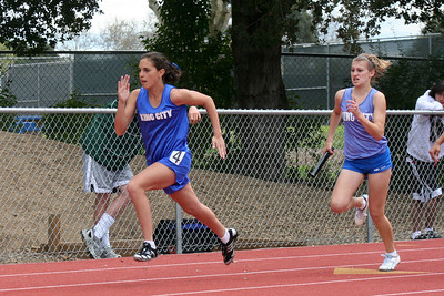 Nathan's girlfriend, Brooke, about to receive the baton in the Girl's 4x100 relay. King City High School at the Gilroy track meet. (Photo by Betsy Roth)