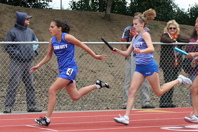 Nathan's girlfriend, Brooke, about to receive the baton in the Brooke and Shelby in the Girl's 4x100 relay. King City High School at the Gilroy track meet. (Photo by Betsy Roth)
