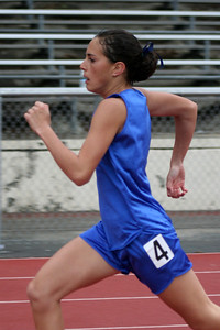 Nathan's girlfriend, Brooke, running the hurdles for King City High School at the Gilroy track meet. (Photo by Betsy Roth)
