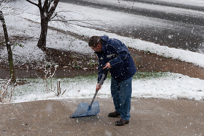 Patrick clearing off the driveway during the first snow of the year. (Image taken by Kathy T. Kane on 05 Dec 2009 with Canon EOS 20D at ISO 400, f7.1, 1/160 sec and 53mm)