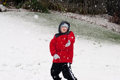 Christopher enjoying the first snow of the year. (Image taken by Kathy T. Kane on 05 Dec 2009 with Canon EOS 20D at ISO 400, f5.6, 1/250 sec and 57mm)