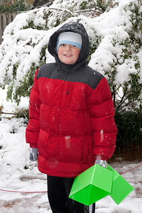 Christopher enjoying the first snow of the year. (Image taken by Kathy T. Kane on 05 Dec 2009 with Canon EOS 20D at ISO 400, f5.0, 1/60 sec and 40mm)