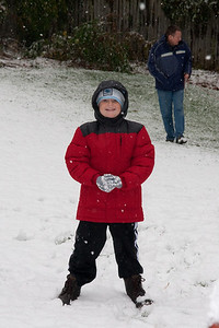 Christopher enjoying the first snow of the year. (Image taken by Kathy T. Kane on 05 Dec 2009 with Canon EOS 20D at ISO 400, f7.1, 1/250 sec and 70mm)
