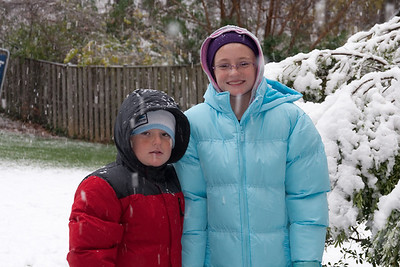 Christopher and Sydney enjoying the first snow of the year. (Image taken by Kathy T. Kane on 05 Dec 2009 with Canon EOS 20D at ISO 400, f5.6, 1/60 sec and 48mm)