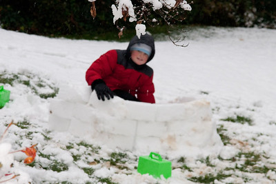 Christopher building a snow fort during the first snow of the year. (Image taken by Kathy T. Kane on 05 Dec 2009 with Canon EOS 20D at ISO 400, f5.6, 1/160 sec and 70mm)