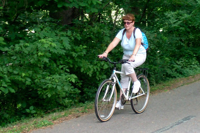 Kathy riding along the trail.  Pat, Kathy, Sydney and Christopher enjoyed a bicycle ride on the Capital Crescent Trail from Fletcher's Boat House to Bethesda and back (10-miles round trip). Fortunately, we finished the ride before the rain in the afternoon. (Image taken with FinePix F10 at ISO 800, f4.9, 1/209 sec and 22.1mm)