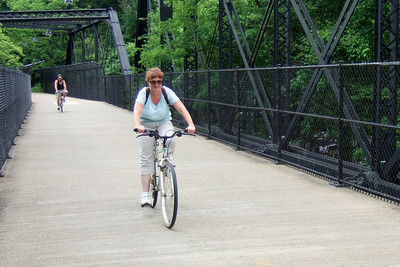 Kathy crossing the Arizona Avenue Bridge.   Pat, Kathy, Sydney and Christopher enjoyed a bicycle ride on the Capital Crescent Trail from Fletcher's Boat House to Bethesda and back (10-miles round trip). Fortunately, we finished the ride before the rain in the afternoon. (Image taken with FinePix F10 at ISO 100, f2.8, 1/250 sec and 8mm)