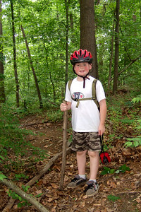 Photo of Christopher by Sydney, who is learning photography at school.  Pat, Kathy, Sydney and Christopher enjoyed a bicycle ride on the Capital Crescent Trail from Fletcher's Boat House to Bethesda and back (10-miles round trip). Fortunately, we finished the ride before the rain in the afternoon. (Image taken with FinePix F10 at ISO 400, f2.8, 1/125 sec and 8mm)