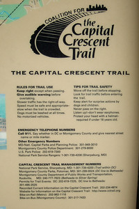 Capital Crescent Trail sign.  Pat, Kathy, Sydney and Christopher enjoyed a bicycle ride on the Capital Crescent Trail from Fletcher's Boat House to Bethesda and back (10-miles round trip). Fortunately, we finished the ride before the rain in the afternoon. (Image taken with FinePix F10 at ISO 200, f3.2, 1/300 sec and 10.4mm)