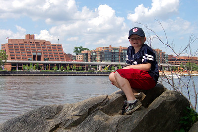 Christopher enjoying the view of Georgetown and the Potomac River from Theodore Roosevelt Island.  The weather was too nice to stay inside, so Pat and Christopher went for a walk around Theodore Roosevelt Island. (Image taken with FinePix F10 at ISO 200, f7.1, 1/480 sec and 12.2mm)