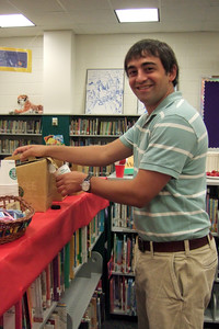 Christopher's 5th Grade Teacher, Jeremy Ferrara. Taylor Elementary School back-to-school teacher breakfast (Image taken by Kathy T. Kane on 31 Aug 2009 with FinePix F10 at ISO 800, f2.8, 1/100 sec and 8mm)