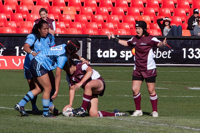 Kathy's neice, Natalie #9, playing in the Australian Women's Rugby League (AWRL) State of Origin game. Her team, Queensland, defeated New South Wales 20 to 14 (18 Jul 2009) (Image taken with Canon EOS 20D at ISO 400, f10.0, 1/1250 sec and 200mm)