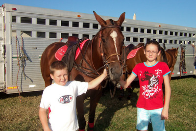 Christopher and Sydney enjoying a visit with one of the polo horses on the National Mall at West Potomac Park. (Image taken by Sydney J. Kane on 19 Sep 2009 with FinePix F10 at ISO 200, f6.4, 1/640 sec and 8mm)