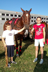 Christopher and Sydney enjoying a visit with one of the polo horses on the National Mall at West Potomac Park. (Image taken by Sydney J. Kane on 19 Sep 2009 with FinePix F10 at ISO 200, f5.6, 1/500 sec and 8mm)