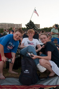 """Christopher, Kathy and Sydney getting ready to enjoy the 4th of July fireworks from the Marine Corps War Memorial in Arlington. Patrick stopped by before lunch to """"reserve"""" a spot with a tarp and a couple of chairs. He left his truck close by and we came back on Metro then went home in the truck. (Image taken by Patrick R. Kane on 04 Jul 2010 with Canon EOS 20D at ISO 400, f5.6, 1/125 sec and 17mm)"""