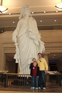 Chris Giacomazzi with Christopher and Sydney Kane in front of the plaster model for the Statue of Freedom at the Capitol Visitor Center (06 Mar 2010) (Image taken by Patrick R. Kane on 06 Mar 2010 with FinePix F10 at ISO 400, f2.8, 1/110 sec and 8mm)