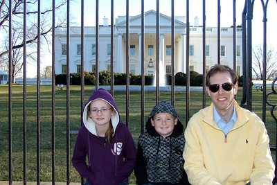 Sydney, Christopher and Chris Giacomazzi in front of the White House (06 Mar 2010) (Image taken by Patrick R. Kane on 06 Mar 2010 with FinePix F10 at ISO 200, f4.0, 1/250 sec and 8.9mm)