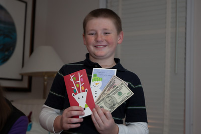 Christopher was extremely happy to receive cash towards an iPod Touch purchase from his grandparents and Aunt KK on Christmas Eve 2010 (Image taken by Patrick R. Kane on 24 Dec 2010 with Canon EOS-1D Mark III at ISO 200, f2.8, 1/60 sec and 35mm)