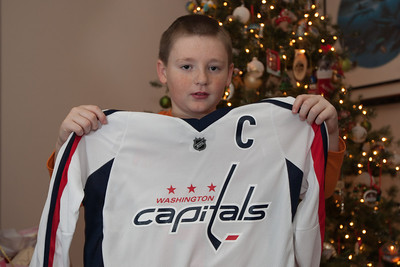 Christopher with a Washington Capitals jersey on Christmas morning 2010 (Image taken by Patrick R. Kane on 25 Dec 2010 with Canon EOS-1D Mark III at ISO 200, f4.0, 1/60 sec and 33mm)