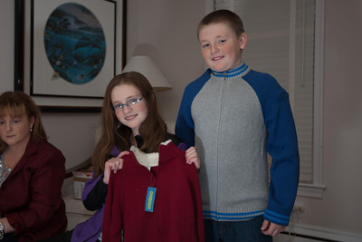 Sydney and Christopher showing off their sweaters from the Moore family on Christmas Eve 2010 (Image taken by Patrick R. Kane on 24 Dec 2010 with Canon EOS-1D Mark III at ISO 200, f2.8, 1/60 sec and 30mm)