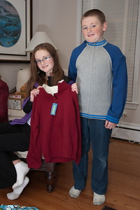 Sydney and Christopher showing off their sweaters from the Moore family on Christmas Eve 2010 (Image taken by Patrick R. Kane on 24 Dec 2010 with Canon EOS-1D Mark III at ISO 200, f2.8, 1/60 sec and 28mm)
