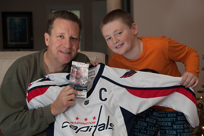 Patrick and Christopher were excited to get tickets and a jersey for the Washington Capitals on Christmas morning 2010 (Image taken by Patrick R. Kane on 25 Dec 2010 with Canon EOS-1D Mark III at ISO 200, f4.0, 1/60 sec and 33mm)