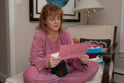 Kathy reading her cards from the kids on Christmas morning 2010 (Image taken by Patrick R. Kane on 25 Dec 2010 with Canon EOS-1D Mark III at ISO 200, f4.0, 1/60 sec and 35mm)
