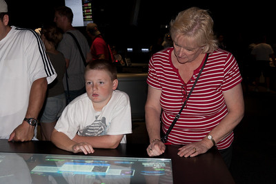 Christopher and Aunt Gale having fun with an interactive exhibit at the National Air and Space Museum (Image taken by Patrick R. Kane on 28 Aug 2010 with Canon EOS 20D at ISO 200, f4.0, 1/60 sec and 25mm)
