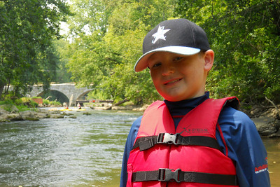 Christopher taking a break on the banks of Antietam Creek just before it enters the Potomac River.   Patrick and Christopher rented a double kayak from River & Trail Outfitters and enjoyed a self-guided trip down Antietam Creek and along the Potomac River. We put in on Antietam Creek at Route 34, floated through Antietam National Battlefield, past Burnside Bridge, over some rapids and under a stone aqua duct at the creek's end. With six miles completed, we paddled an additional four against the wind on the Potomac River to the Dargan Bend boat ramp (near mile marker 65 on the C&O Canal). We spotted a bunch of turtles, a few crayfish and cranes, and even a bald eagle. It was a great trip. (Image taken by Patrick R. Kane on 21 Aug 2010 with COOLPIX S570 at ISO 160, f4.0, 1/250 sec and 11.2mm)