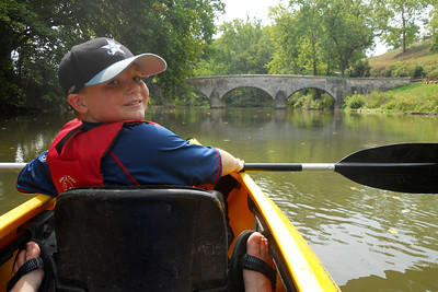 Christopher heading toward the historic Burnside Bridge. The bridge, built in 1836, played a key role in the Battle of Antietam on September 17, 1862, when a small number of Confederate soldiers held off repeated attempts by the Union Army to take the bridge by force. This Battle remains the bloodiest single-day battle in American history.   Patrick and Christopher rented a double kayak from River & Trail Outfitters and enjoyed a self-guided trip down Antietam Creek and along the Potomac River. We put in on Antietam Creek at Route 34, floated through Antietam National Battlefield, past Burnside Bridge, over some rapids and under a stone aqua duct at the creek's end. With six miles completed, we paddled an additional four against the wind on the Potomac River to the Dargan Bend boat ramp (near mile marker 65 on the C&O Canal). We spotted a bunch of turtles, a few crayfish and cranes, and even a bald eagle. It was a great trip. (Image taken by Patrick R. Kane on 21 Aug 2010 with COOLPIX S570 at ISO 80, f2.7, 1/400 sec and 5mm)