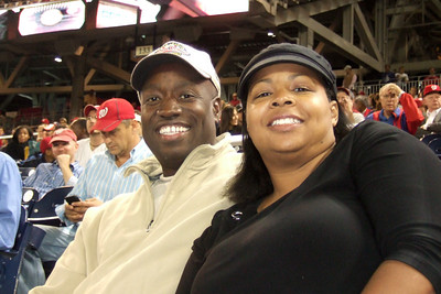 Ms. Stephanie and Ron. The Kinhaven School teachers and staff enjoyed a trip to the ball park to watch the Washington Nationals play the Florida Marlins. Unfortunately, the Nats lost 1 to 3; however, that didn't stop everyone from having a great time. (Image taken by Kathy T. Kane on 10 Sep 2010 with FinePix F10 at ISO 800, f3.7, 1/100 sec and 14.1mm)