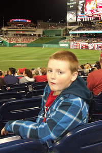 Christopher enjoying great seats for the Washington Nationals vs. Florida Marlins game. Unfortunately, the Nats lost 1 to 3; however, that didn't stop everyone from having a great time. (Image taken by Kathy T. Kane on 10 Sep 2010 with FinePix F10 at ISO 400, f2.8, 1/150 sec and 8mm)
