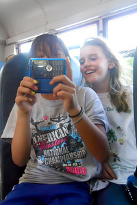 Mia and Erin on the bus ride back from Taylor Elementary School 5th Grade's overnight field trip to the Arlington Outdoor Lab (Image taken by Christopher R. Kane on 24 Sep 2010 with COOLPIX S570 at ISO 800, f2.7, 1/125 sec and 5mm)