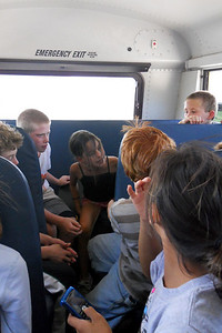 Michael, Sylvia and Matt riding in the back of the bus on the way home from Taylor Elementary School 5th Grade's overnight field trip to the Arlington Outdoor Lab (Image taken by Christopher R. Kane on 24 Sep 2010 with COOLPIX S570 at ISO 400, f2.7, 1/200 sec and 5mm)