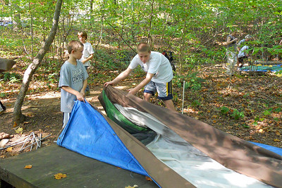 Matt and Michael setting up a tent during the Taylor Elementary School 5th Grade's overnight field trip to the Arlington Outdoor Lab (Image taken by Christopher R. Kane on 24 Sep 2010 with COOLPIX S570 at ISO 400, f2.7, 1/125 sec and 5mm)