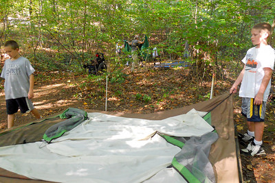 Matt and Michael setting up a tent during the Taylor Elementary School 5th Grade's overnight field trip to the Arlington Outdoor Lab (Image taken by Christopher R. Kane on 24 Sep 2010 with COOLPIX S570 at ISO 400, f2.7, 1/160 sec and 5mm)