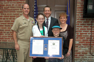 Patrick Kane, accompanied by his family, Kathy, Sydney and Christopher, and the Naval Facilities Engineering Command (NAVFAC) Chief of Staff, Captain Bob Gibbs, after his award ceremony. Pat received the Navy Meritorious Civilian Service Award for his support of the Navy expeditionary forces ashore while serving as Deputy Director of the NAVFAC Expeditionary Programs Office (NEPO). (Image taken by Kathy T. Kane on 11 May 2010 with FinePix F10 at ISO 800, f2.8, 1/120 sec and 8mm)