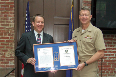 Rear Admiral Greg Shear awarding Patrick Kane the Navy Meritorious Civilian Service Award for his support of the Navy expeditionary forces ashore. Pat is the Deputy Director of the Naval Facilities Engineering Command (NAVFAC)Expeditionary Programs Office (NEPO). (Image taken by Kathy T. Kane on 11 May 2010 with FinePix F10 at ISO 800, f2.8, 1/125 sec and 8mm)