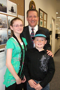 Pat with Sydney and Christopher outside his office at the Naval Facilities Engineering Command (NAVFAC) in the Washington Navy Yard. (Image taken by Kathy T. Kane on 11 May 2010 with FinePix F10 at ISO 800, f2.8, 1/100 sec and 8mm)
