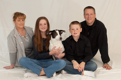 Kathy, Sydney (almost 13), Dolly, Christopher (almost 11) and Patrick in an attempt to get a good Christmas picture. We ended up retaking the pictures the following weekend with more success. (Image taken by Patrick R. Kane on 07 Nov 2010 with Canon EOS-1D Mark III at ISO 200, f5.6, 1/0.5 sec and 50mm)