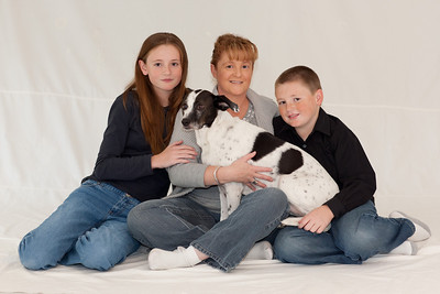 Kathy with Sydney (almost 13), Christopher (almost 11) and Dolly in an attempt to get a good Christmas picture. We ended up retaking the pictures the following weekend with more success. (Image taken by Patrick R. Kane on 07 Nov 2010 with Canon EOS-1D Mark III at ISO 200, f2.8, 1/15 sec and 85mm)