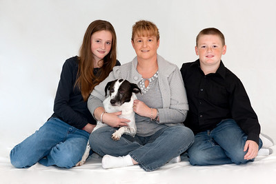 Kathy with Sydney (almost 13), Christopher (almost 11) and Dolly in an attempt to get a good Christmas picture. We ended up retaking the pictures the following weekend with more success. (Image taken by Patrick R. Kane on 07 Nov 2010 with Canon EOS-1D Mark III at ISO 200, f4.0, 1/6 sec and 85mm)