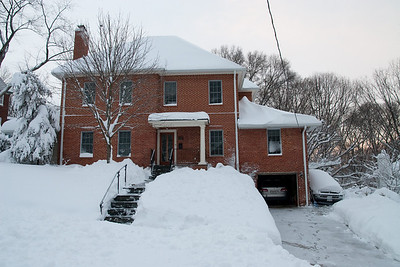 Our house on 26th Street N. After getting several inches of snow on Wednesday, it started snowing again on Friday, February 5th, around 10 a.m. and snowed steadily until Saturday late afternoon leaving over two feet of snow. (Image taken by Patrick R. Kane on 06 Feb 2010 with Canon EOS 20D at ISO 400, f5.6, 1/125 sec and 17mm)